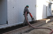 Image of a technician installing Gro-Bark® Green Roof Media and ottawa turf soil