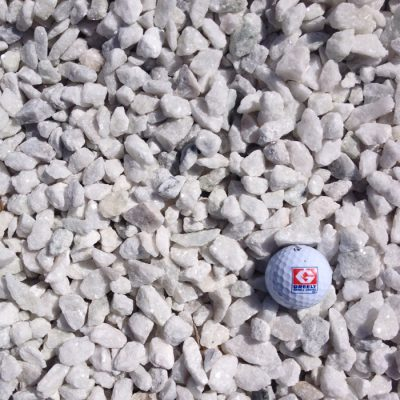 Greely Sand & Gravel 1/2 inch to 3/4 inch white stone with golf ball for size