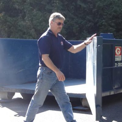 opening a Greely Sand & Gravel portable dumpster